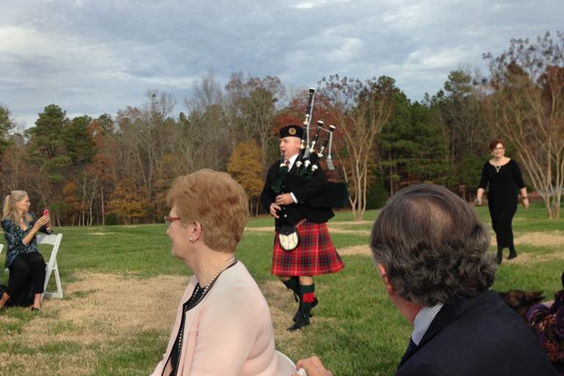 Bagpiping at a funeral with honor guard